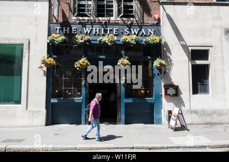 The White Swan public house and chophouse, formerly the Mucky Duck, on Fetter Lane, London, UK - Stock Photo