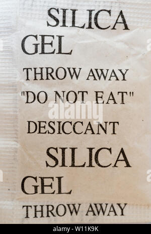 Small bag of silica gel as put into parcels etc. UK - Stock Photo