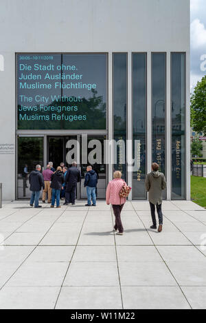 Munich, Bavaria, Germany - May 18, 2019. Tourists walking towards the the entrance of N-S documentation center for the history of national socialism. - Stock Photo