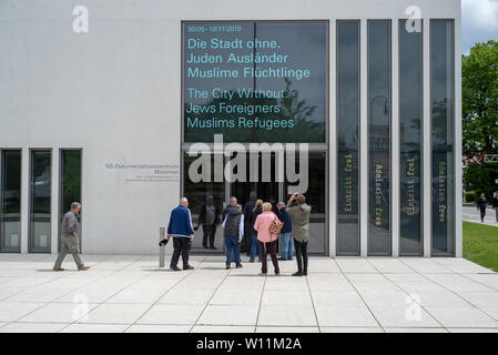 Munich, Bavaria, Germany - May 18, 2019. Tourists entering the N-S documentation center for the history of national socialism. - Stock Photo