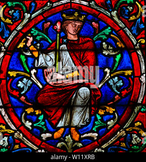 Stained Glass in the Cathedral of Notre Dame, Paris, France, depicting King Solomon as part of the Tree of Jesse, the ancestors of Jesus Christ - Stock Photo