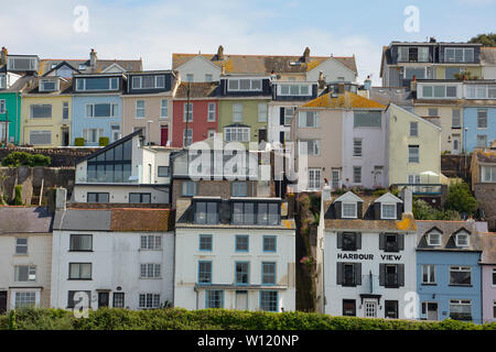 Colourful houses overlooking Brixham Harbour in June. Tourism and fishing are the town's main industries. Devon England UK GB - Stock Photo