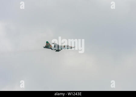 Su25 military plane fly on cloudy day - Stock Photo