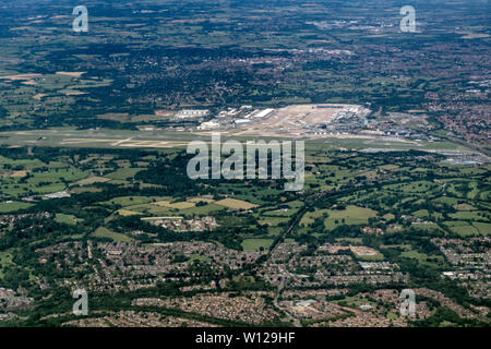 Aerial photograph of Manchester Airport from above with pilots viewpoint - Stock Photo