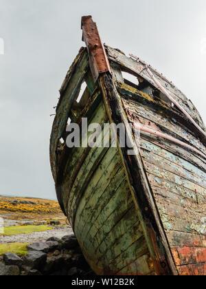 Shipwrecked fishing boats on the Scottish isle of Mull - Stock Photo