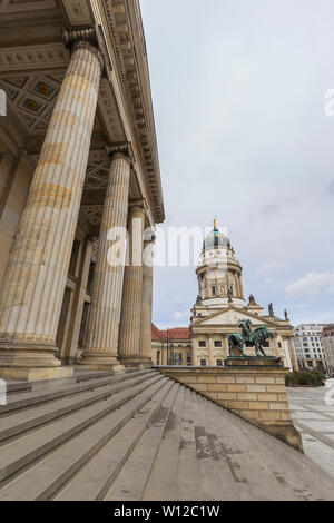 Facade of the Konzerthaus Berlin (Berlin Concert Hall) and Französischer Dom (French Cathedral) at the Gendarmenmarkt Square in Berlin, Germany. - Stock Photo