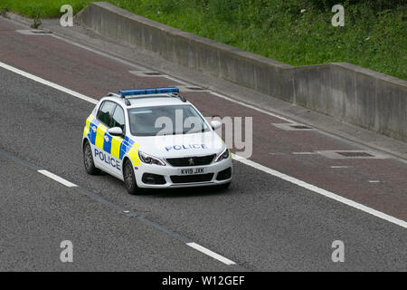 Peugeot 308 Access Bluehdi S/S Police car on the M6, Lancaster, UK; Vehicular traffic, transport, modern, saloon cars, north-bound on the 3 lane highway. - Stock Photo
