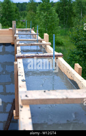 Foundation site of new house, building, details and reinforcements with steel bars - Stock Photo