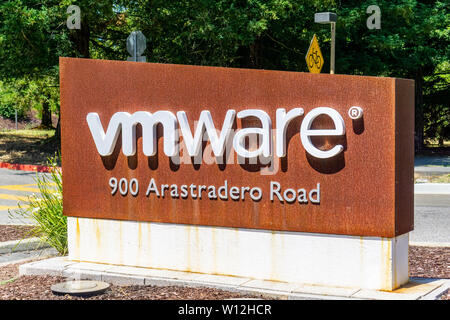 June 21, 2019 Palo Alto / CA / USA - Sign located at the entrance to VMware offices located in Silicon Valley; VMware provides cloud computing and pla - Stock Photo