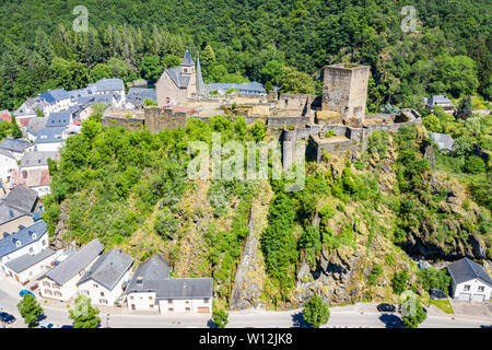 Aerial view of Esch-sur-Sure, medieval town in Luxembourg, dominated by castle, canton Wiltz in Diekirch. Forests of Upper-Sûre Nature Park, meander o - Stock Photo