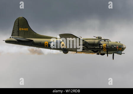 Sally B, the preserved Boeing B-17 Flying Fortress bomber taking part in the last Wings & Wheels Airshow held at Dunsfold Aerodrome, UK on 16/6/19. - Stock Photo