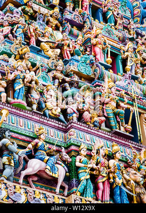 SINGAPORE, SINGAPORE - MARCH 2019: Intricate Hindu art and deity carvings on the facade of Sri Veeramakaliamman Temple in Little India, Singapore. - Stock Photo