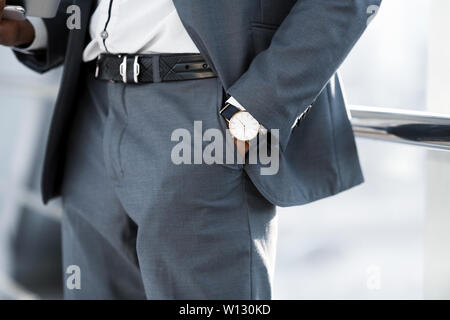Man Hand with Wrist Watch in the Pocket of Stylish Pants - Stock Photo