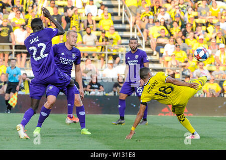 Saturday, June 29, 2019: Columbus Crew SC forward Robinho (18) attempts a bicycle kick while Orlando City defender Lamine Sane (22) protects his face the first half of the match between Orlando City and Columbus Crew SC at MAPFRE Stadium, in Columbus OH. Mandatory Photo Credit: Dorn Byg/Cal Sport Media. Orlando City 1 - Columbus Crew SC 0 after the first half - Stock Photo