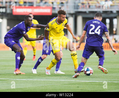 June 29, 2019: Columbus Crew SC forward JJ Williams (yellow) fights for the ball against the Orlando defense in their game in Columbus, Ohio, USA. Brent Clark/Alamy Live News - Stock Photo