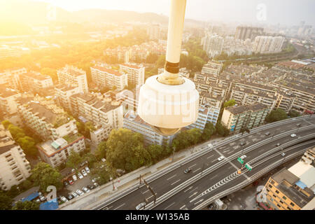 busy traffic on viaduct among modern skyscrapers under monitoring camera - Stock Photo