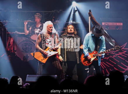 Rickey Medlocke, Johnny Van Zant and Gary Rossington on stage as Lynyrd Skynyrd play the London date of their 'Last of the Street Survivors Farewell Tour' at SSE Wembley Arena - Stock Photo
