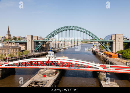 The view from the High Level Bridge over the River Tyne to the Swing and Tyne Bridges.  The bridges connect Newcastle upon Tyne and Gateshead. - Stock Photo