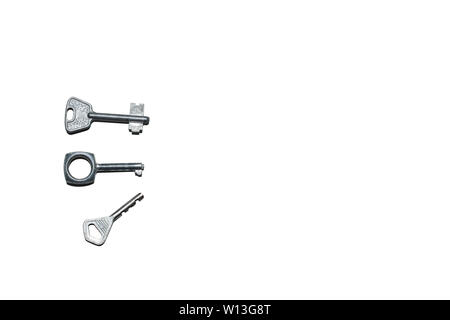 Three old different keys isolated on the white background with copy space. - Stock Photo