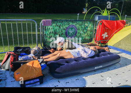 Wimbledon, London. UK . 30th June 2019. Tennis fans bring their camping gear to  queue  overnight for tickets  to the  2019 Wimbledon Lawn Championships.  Wimbledon remains one of the very few major UK sporting events where tennis enthusiasts can purchase  tickets on the day of play which start on 1 July . Credit: amer ghazzal/Alamy Live News - Stock Photo