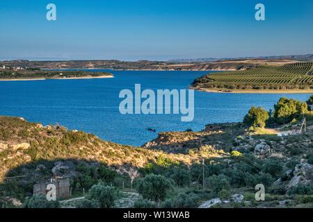 Embalse de Mequinenza (Mar de Aragón) reservoir on Ebro river near town of Ebro, Zaragoza province, Aragon, Spain - Stock Photo