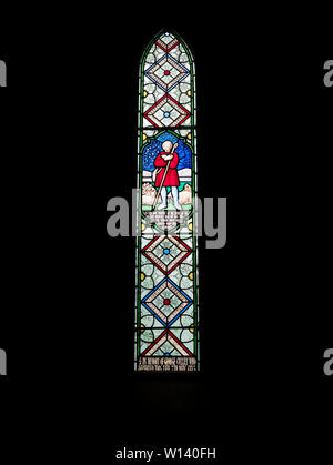 One of several Victorian Stained Glass Windows within the Church of St Michael and All Angels next to Ford Castle in Northumberland. - Stock Photo