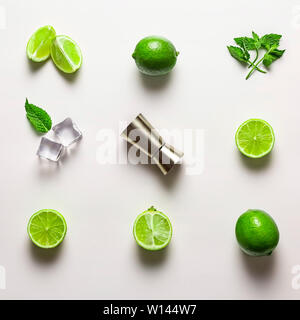 Mojito lime set, flat lay on white background. Ingredients, ice and jigger. Concept: Mojito Cocktail - Stock Photo