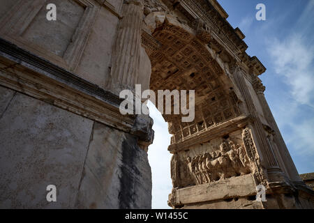 Arch of Trjan in the ancient roman forum in Rome - Stock Photo