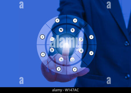 businessman pressing modern social buttons on social network interface with finger hand touch technology icon on blue background and copy space add te - Stock Photo