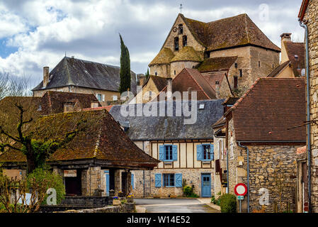 Creysse, a typical french village in Haut Quercy, Lot department, Martel, France, with traditional blue window shutters, brown brick buildings, tiled - Stock Photo
