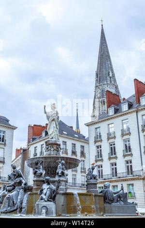 Main Square, fountain and church. Nantes, France - Stock Photo