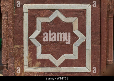 11-jun-2004 A decorative eight pointed star in a square made from white marble inlaid in red sandstone.humayun tomb Delhi INDIA - Stock Photo