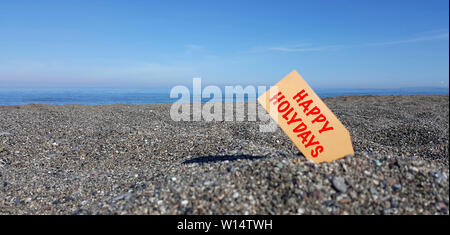 Tag on the beach with text Happy Holidays - Stock Photo