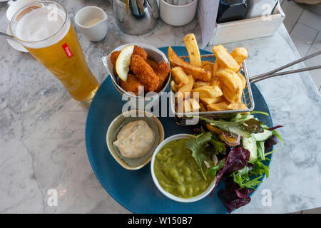 Scampi and chips with salad garden peas and tartare sauce and a glass of  Peroni lager at Seaview Café Saltburn by the sea - Stock Photo