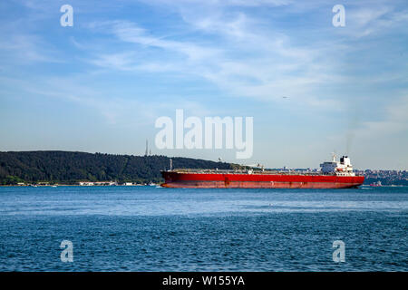 A red big freighter is going to Black Sea from Marmara Sea in Bosphorus, Istanbul - Stock Photo