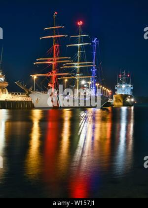 12.05.2019, the 'Eagle' is the sailing training ship of the United States Coast Guard in the evening in Tirpitzhafen in Kiel. Original one sail training ship of the German Navy with the name 'Horst Wesel', it was after the end of the war in 1946 as a reparation in the US. Traditionally, all Coast Guard ships are referred to as cutters. Therefore the Prafix USCGC = United States Coast Guard Cutter. From 10 to 14 May, she visited the naval base in Kiel. As the German sailing training ship 'Gorch Fock', she is one of six sailing ships of the 'Gorch Fock' class. | usage worldwide - Stock Photo