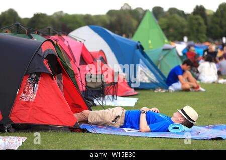 Campers queue for the first day of the 2019 Wimbledon Championships at the All England Lawn Tennis and Croquet Club, London. - Stock Photo