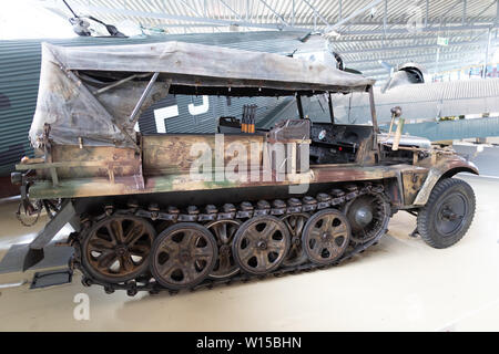 A half-track military vehicle used by the German Wehrmacht Heer, Luftwaffe and Waffen-SS during the Second World War on museum display at Gardemoen. - Stock Photo