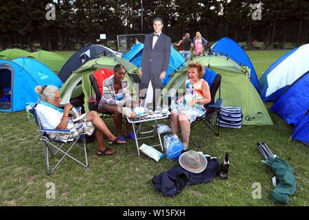 Campers from Bristol and Cheshire with a cardboard cut out of Rafael Nadal as they queue for the first day of the 2019 Wimbledon Championships at the All England Lawn Tennis and Croquet Club, London. - Stock Photo