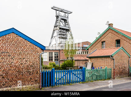 The former miners' housing next to the Arenberg pit are modest, semi-detached, brick houses typical from the Nord-Pas de Calais mining basin, France. - Stock Photo