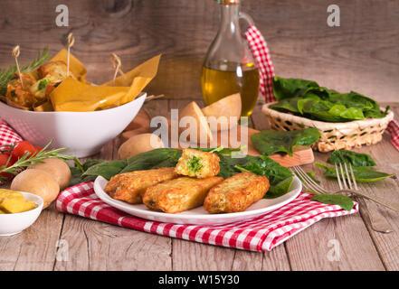 Potato croquettes with spinach and mozzarella. - Stock Photo