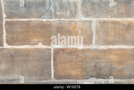 Old wall made large stone blocks. - Stock Photo
