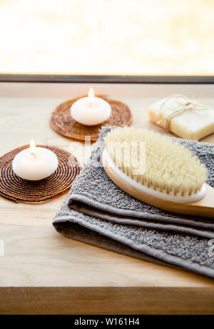 Dry brushing the skin in a pattern with a dry brush, usually before showering help reduce cellulite and remove toxins in human body. Selective focus n - Stock Photo