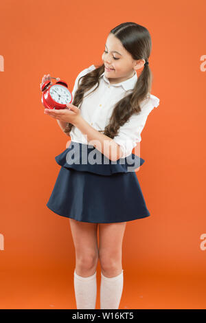 School time. Children education. Knowledge day. time to go to school. Happy girl hold alarm clock counting for lunch time. daily routine schedule. schoolgirl and retro alarm clock. Back to school. - Stock Photo