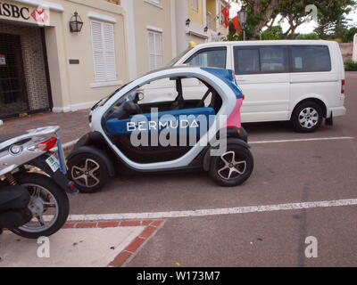 Renault Twizy at St. George's square near the HSBC bank. The Twizzy is seen emblazoned with the logo 'BERMUDA' in pink and blue. A new efficient mode. - Stock Photo