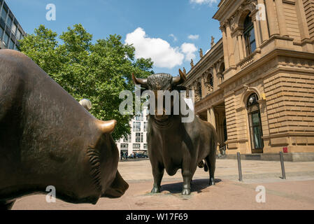FRANKFURT, GERMANY - JUNE 17, 2019: Bull and bear in front of the Frankfurt Stock Exchange - Stock Photo