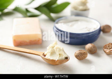 Spoon with shea butter on light background - Stock Photo