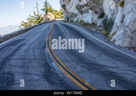 Spectacular serpentine of the rocky road on mountain Wilson, San Gabriel Mountains, California - Stock Photo