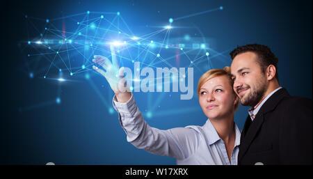 Man and woman touching hologram screen displaying modern web system