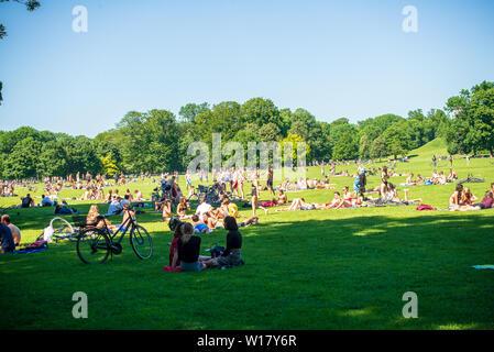 Munich,Germany-June 28,2019: Crowds flock to the Englischer Garten Park in Munich enjoying the hot weather - Stock Photo